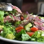 Steak Salad Close Up Action Shot with watermark