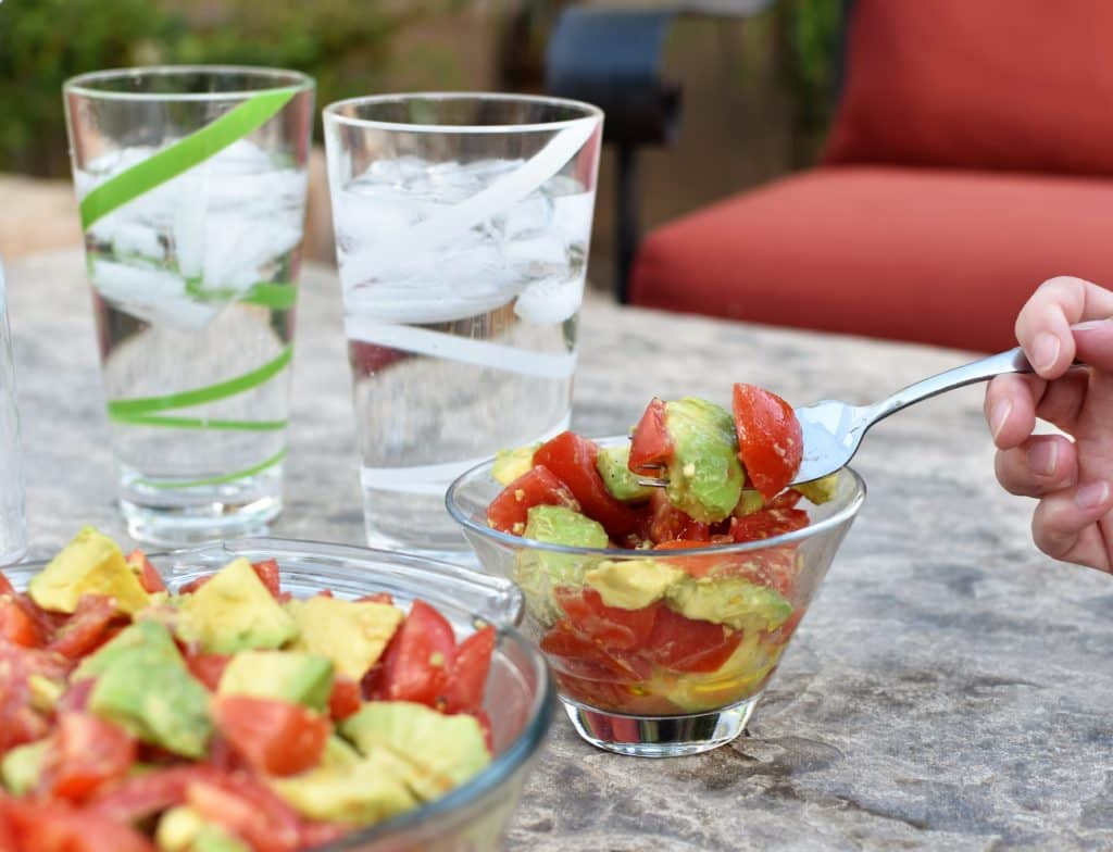 Avocado Tomato Salad Action Shot for Outdoor Cooking