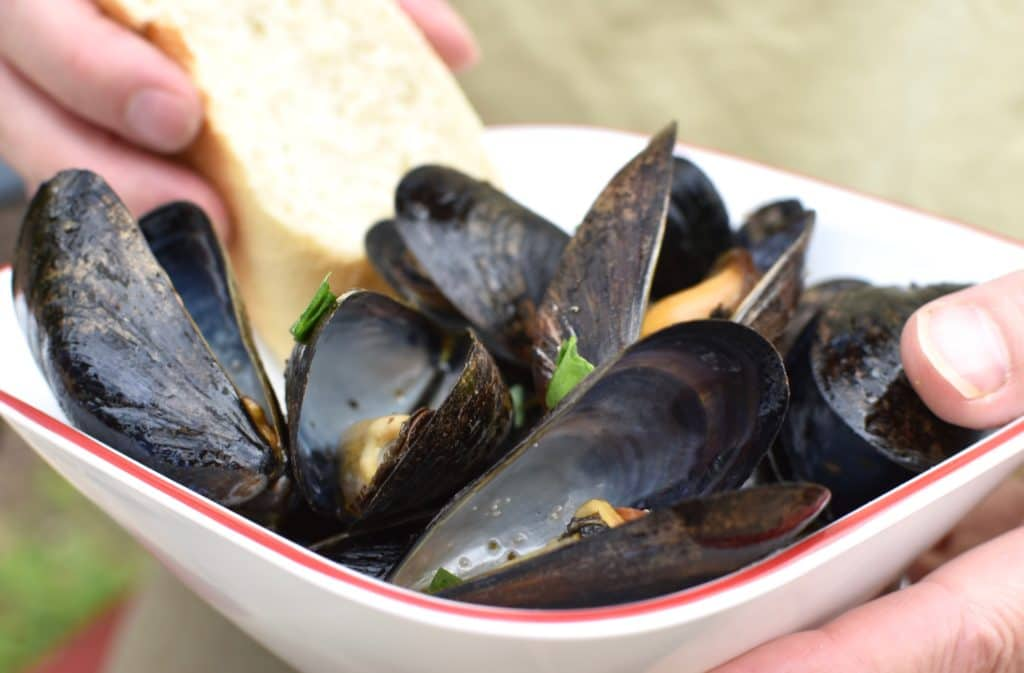 good camping food great mussels with hands