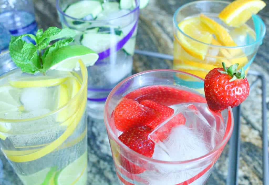 Hydration Dasani Water in fruit glasses close up e