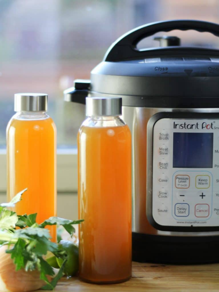 Instant Pot Bone Broth Veritacal with pot and jars
