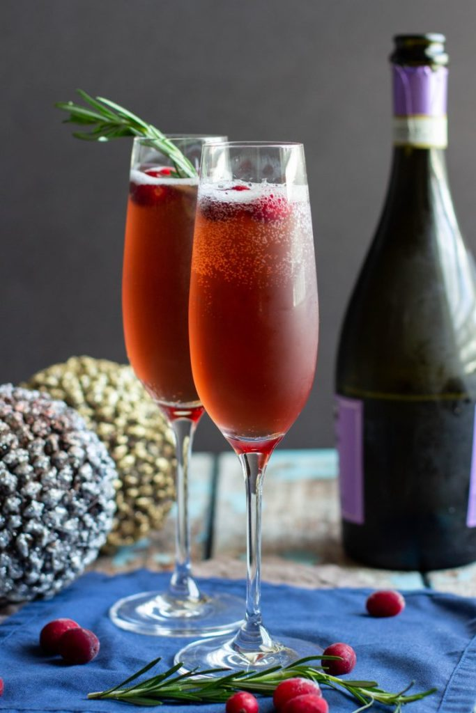 Cocktails with cranberry juice rosemary french 75 vertical
