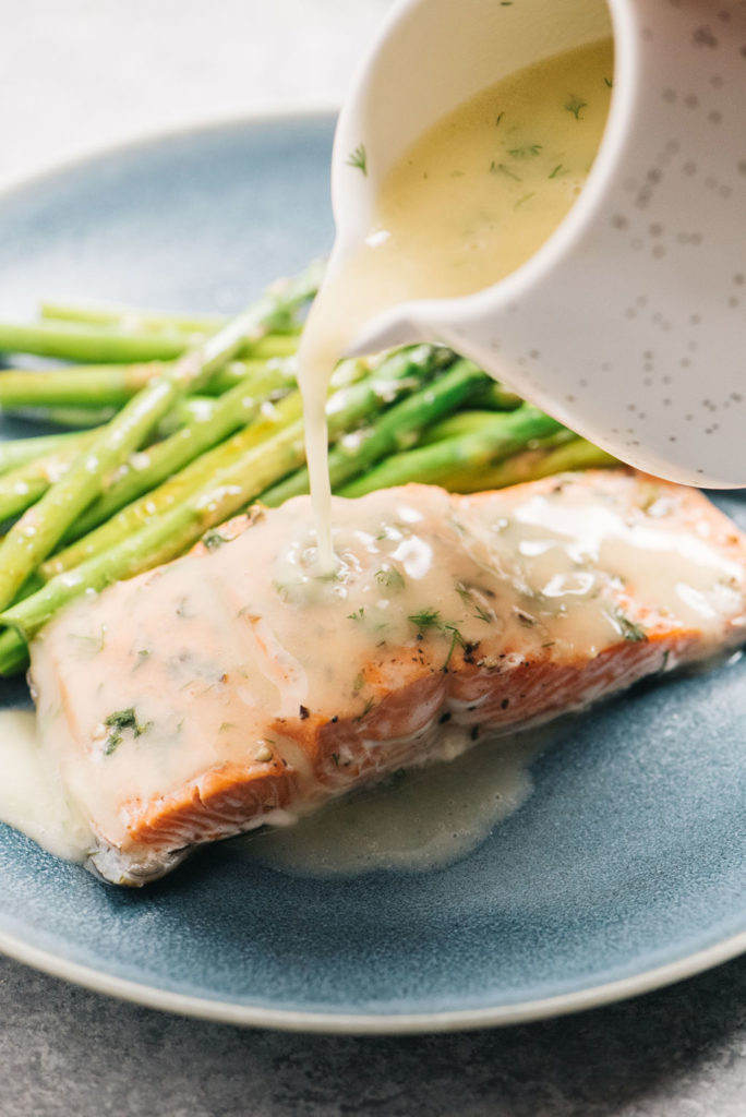 Pressure Cooker Salmon with lemon dill sauce being poured