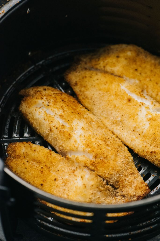 Air fryer tilapia in air fryer basket