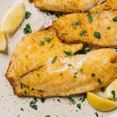 Air fryer tilapia on platter horizontal