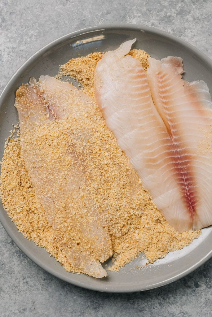 Tilapia in pan with breading