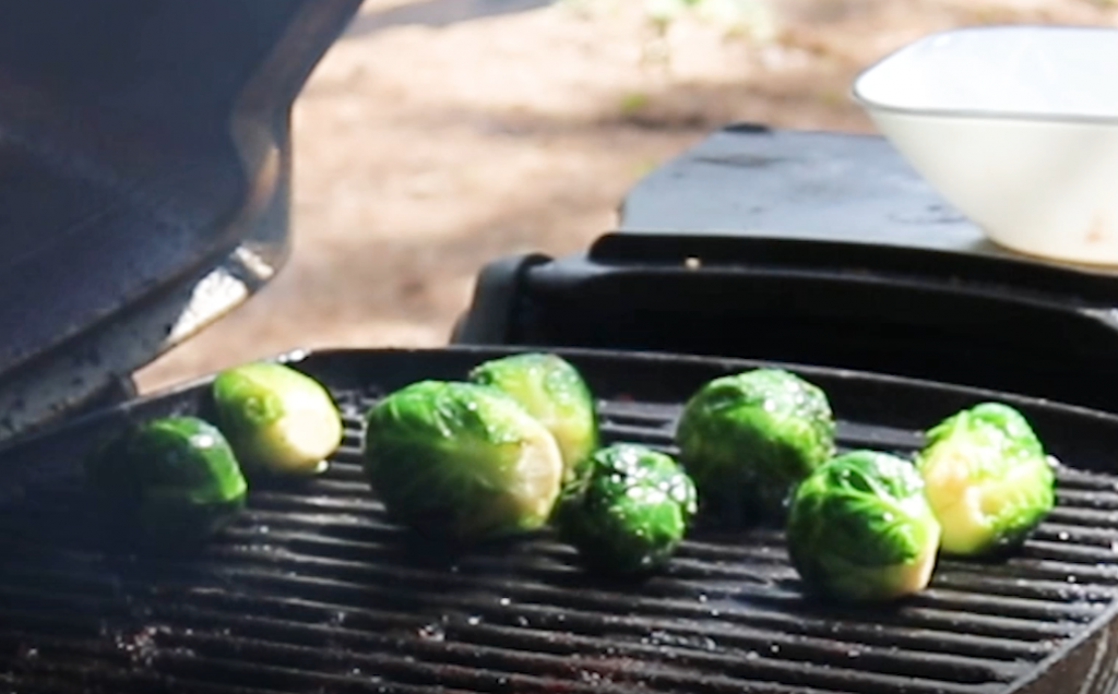 Grilled Brussels sprouts on a hot grill