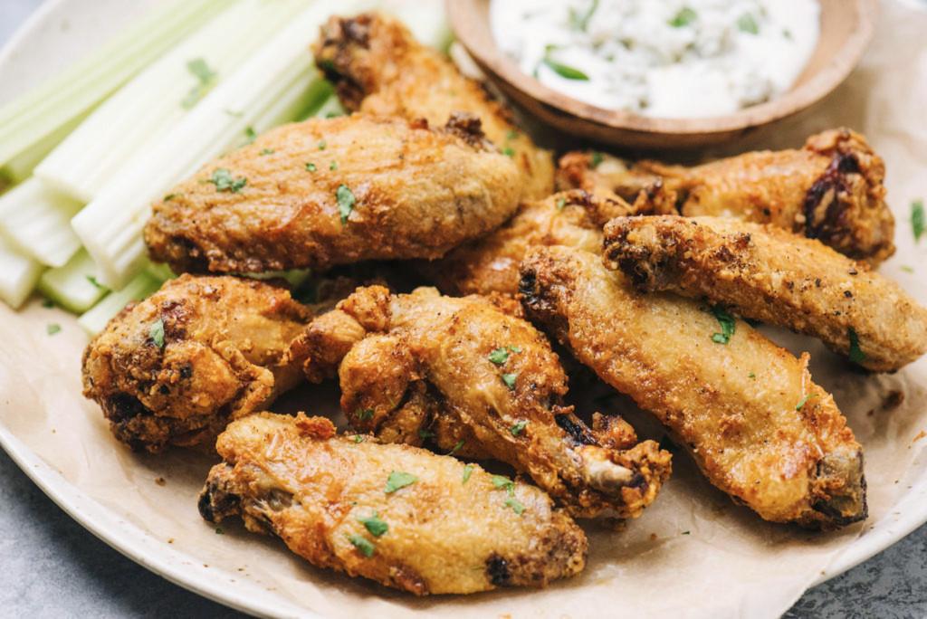 Horizontal Air fryer chicken wings on plate edit